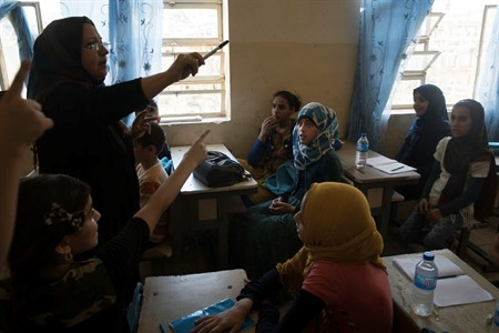 Schools in Iraq face desk deficit